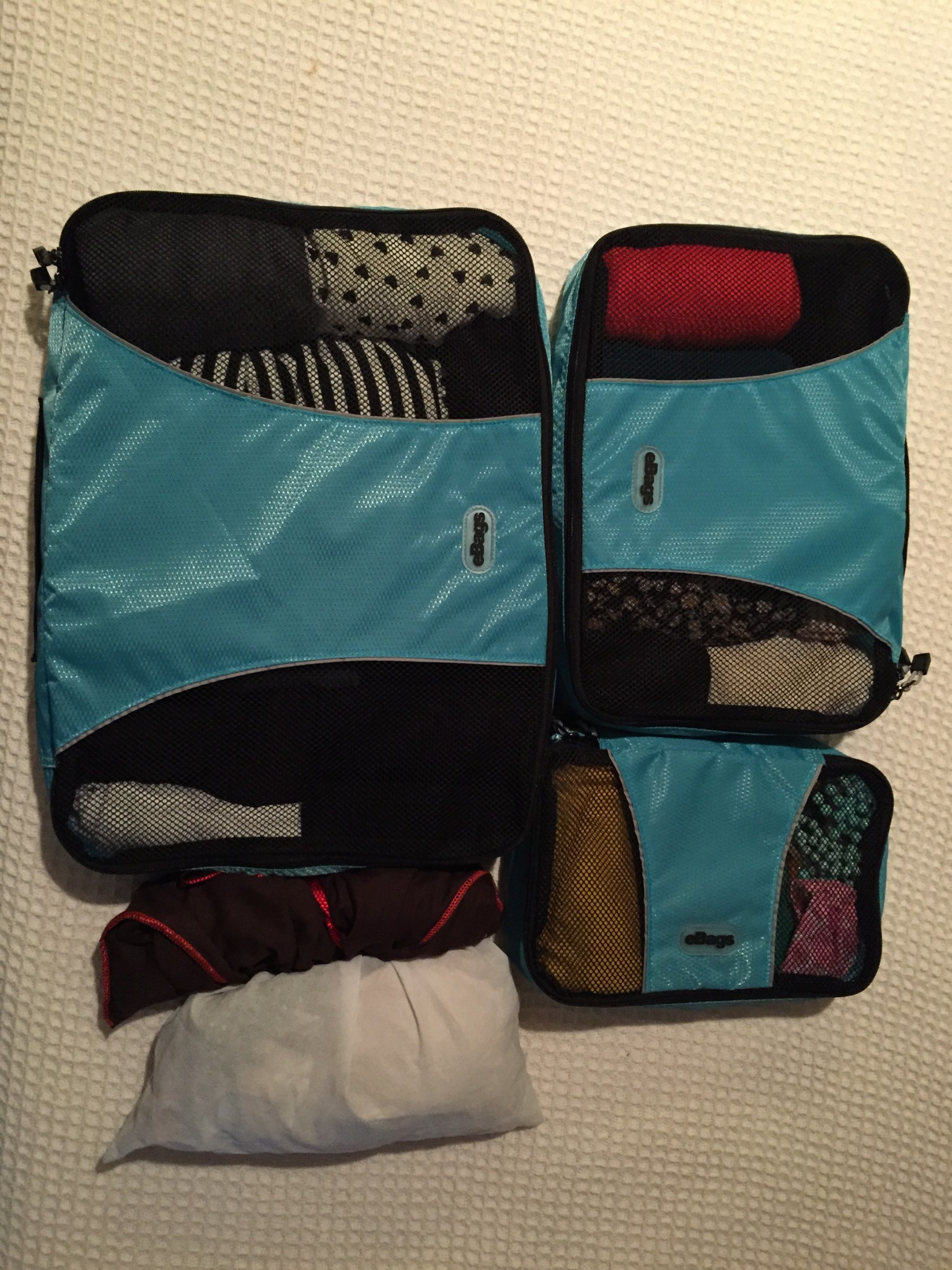 Packing cubes can hold a massive amount of clothes and keep everything incredibly organized. I also like to use small fabric bags to organize smaller things.