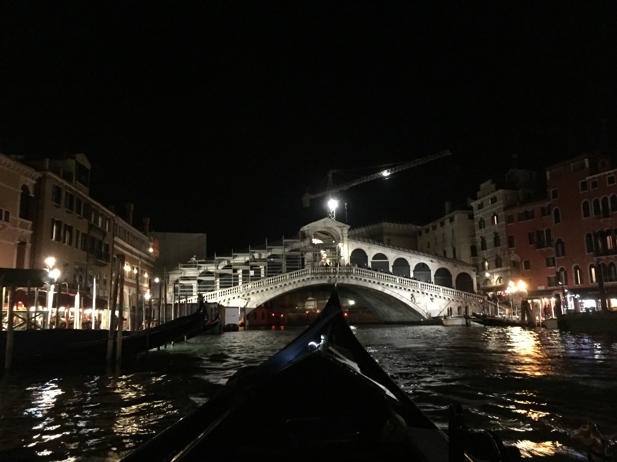 The Rialto Bridge is even prettier at night when seen from the waterways.