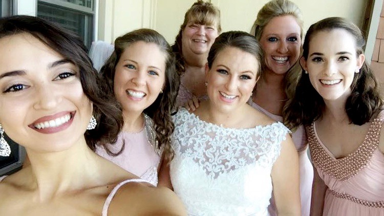 It's not a real wedding without a few selfies with the bride.