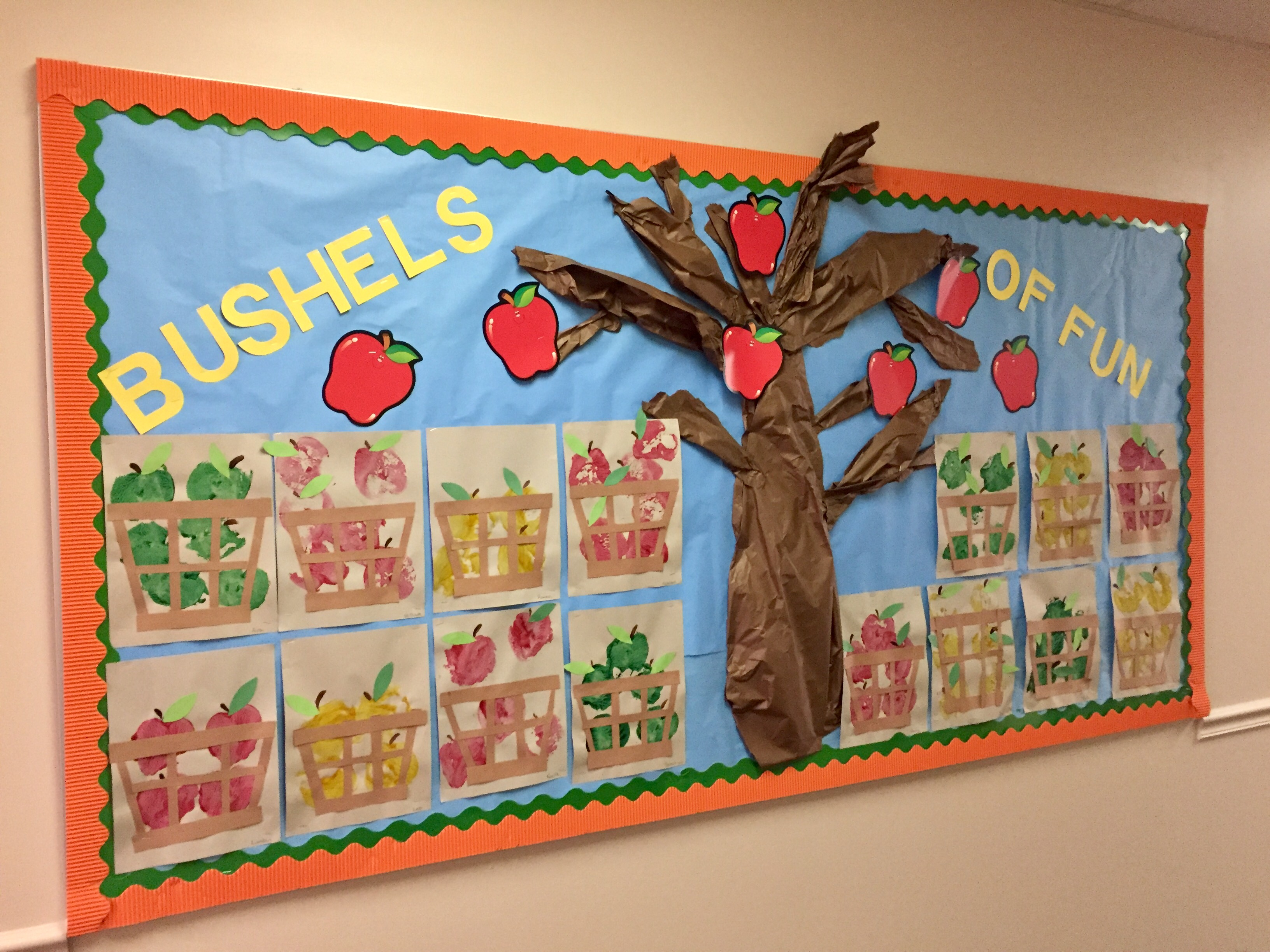 Our fall bulletin board that was created with our apple stamping projects.