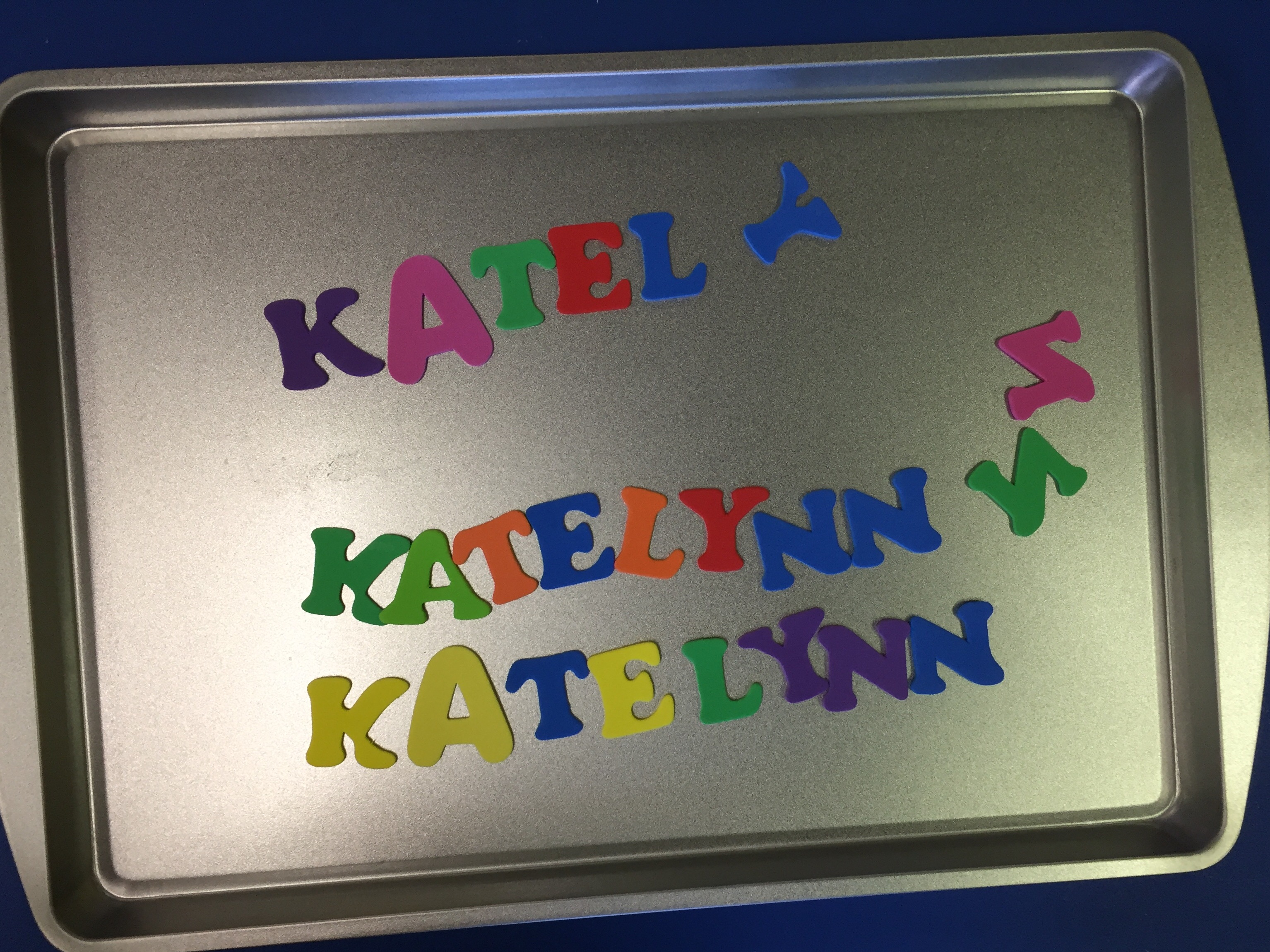 Another great way to teach their names and use a cookie sheet is to use foam letters. The kids are given a bag with all of their letters and they have to go spell their name out on the cookie sheet.