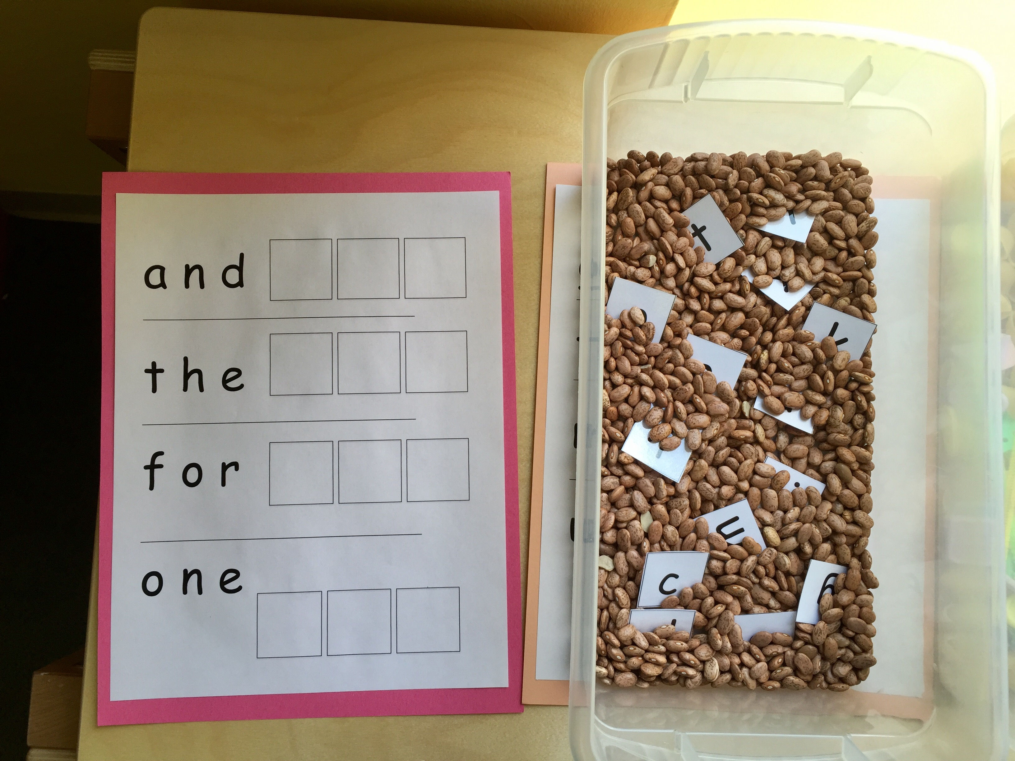 Sight words are a huge part of early childhood and elementary school, so we created these laminated sheets of sight words that we are covering in class. The kids have letters in a bin and they have to spell out the sight words.